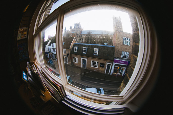 A street view through a window showing fish-eye distortion